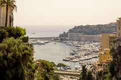 Framed view of Port Hercule in Monaco in a summer day. Cote d`Azur French Riviera is situated in the southern eastern part of the mediterranean coast of France stock image