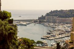 Framed view of Port Hercule in Monaco in a summer day. Cote d`Azur French Riviera is situated in the southern eastern part of the mediterranean coast of France stock images