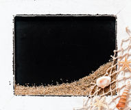 Framed vintage slate with shells and fishing net Stock Photo