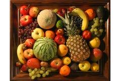 Framed Whole Fruit. Fresh whole fruits in wooden frame Stock Image