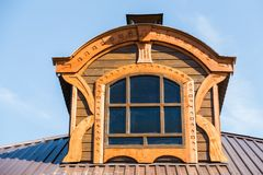 Framed window on the tile roof. Against the blue sky Royalty Free Stock Images