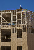 Framer on Condo Unit. A framer on a wood structure under construction Stock Photography