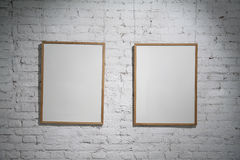 Frames. Two frame on brick wall Stock Photos