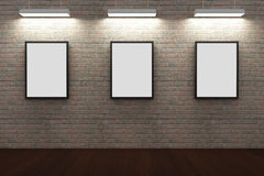 Frames on brick wall Royalty Free Stock Photos