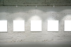 Frames on brick wall Stock Photography