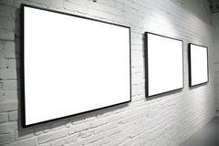 Frames on brick wall royalty free stock image