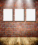 Frames on brick wall royalty free stock images
