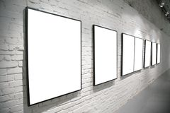 Frames on brick white wall Royalty Free Stock Photography