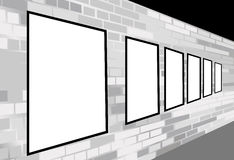 Frames on brick white wall Royalty Free Stock Images