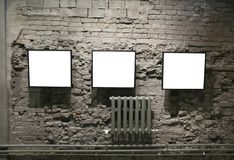 Frames on the bricks wall Royalty Free Stock Photography