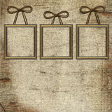 Frames with brown bow on grunge background Stock Photo