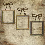 Frames with brown bow on grunge background Stock Image