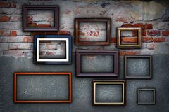 Frames on cracked ancient wall Stock Photography