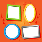 Frames on cracked wall. Set of fun empty frames in bright colors for your text or images hung on cracked old house orange wall Royalty Free Stock Images