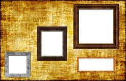 Frames da foto em uma parede de Grunge Fotografia de Stock Royalty Free