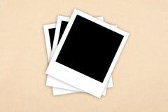 Frames da foto no fundo de papel Imagem de Stock