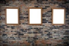 Frames de madeira da foto na parede fotografia de stock royalty free