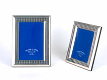 Frames de retrato de prata de encontro ao fundo branco Imagem de Stock