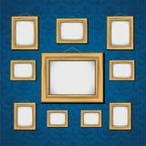 Frames de retrato na parede azul Foto de Stock Royalty Free