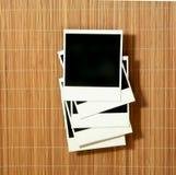 Frames dos Polaroids do vintage jogados no bambu Foto de Stock Royalty Free