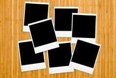 Frames em branco da foto no bambu Imagens de Stock