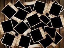 Frames envelhecidos da foto no fundo de madeira Foto de Stock Royalty Free