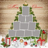 Frames for family, Christmas decorations and gifts on wooden background