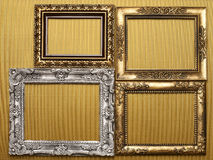 Frames on gold background Stock Photos