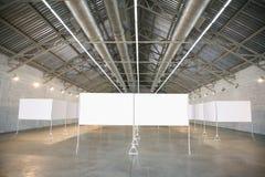 Frames in hangar. Blank white frames in hangar Stock Images