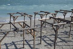 Frames of logs for awnings on the beach. The beach of Novorossiysk.  Royalty Free Stock Image