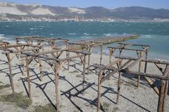 Frames of logs for awnings on the beach. The beach of Novorossiysk.  Stock Images