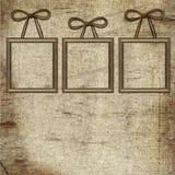 Frames met bruine boog op grungeachtergrond Stock Foto
