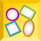 Frames or mirrors at bottom of a box. Set of empty frames in fun bright colors for your text or images, could be mirrors, placed at the bottom of cardboard box Royalty Free Stock Photography