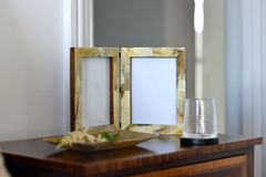Frames. Natural horn picture frames in a bedroom setting Stock Image