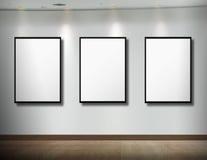 Frames op witte muur Royalty-vrije Stock Foto