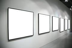 Frames op witte muur Royalty-vrije Stock Afbeelding