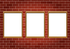 Frames for paintings or photographs on the brick wall background Stock Photo