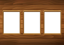 Frames for paintings or photographs on the brick wooden backgrou Stock Photos
