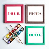 Frames, palette and painbrushes. Stock Photography