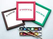 Frames, palette and painbrushes. Stock Photos