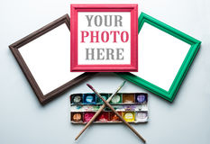 Frames, palette and painbrushes. Royalty Free Stock Photo