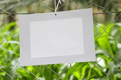Frames of paper hanging in the fence of fodder farms royalty free stock image