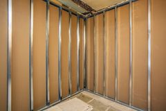 Frames for plasterboard for making gypsum walls on the brick wall in an apartment is under construction, overhaul stock images