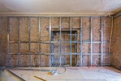 Frames for plasterboard for making gypsum walls on the brick wall in an apartment is under construction, remodeling. Frames for plasterboard metal profiles for Stock Photo