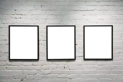 Frames pretos na parede de tijolo branca 3 Fotografia de Stock Royalty Free
