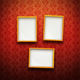 Frames on red vintage background. Three Picture frames in gold on red vintage background Royalty Free Stock Photography