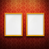 Frames with red vintage wallpaper. Empty golden frames with red vintage wallpaper Stock Photos