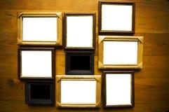 Frames vazios na parede de madeira Fotos de Stock Royalty Free