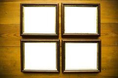 Frames vazios na parede de madeira Imagem de Stock