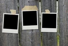 Frames velhos da foto na cerca Fotografia de Stock Royalty Free